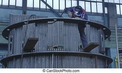 Gas tungsten arc welding on a high platform - Welding a...
