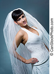 Smiling bride - Bride posing and smiling wearing classic...
