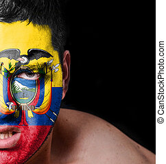 Portrait of angry man with painted flag of Ecuador