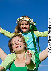 Woman and girl enjoy the spring sun