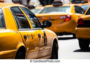 Yellow cab speeds through Times Square in New York, NY, USA...