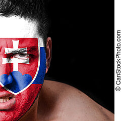 Portrait of angry man with painted flag of Slovakia