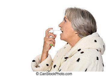 Sick elderly lady with inhaler