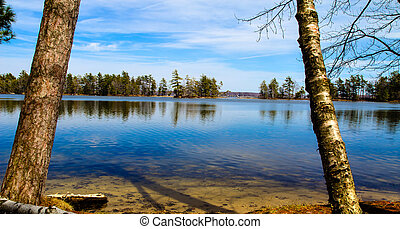 Summer Days - View of the blue waters of Lost Lake on a warm...