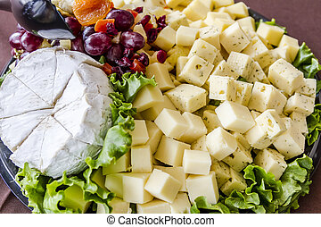 Assorted Fruit and Cheese Tray - Assorted cubes of cheese,...