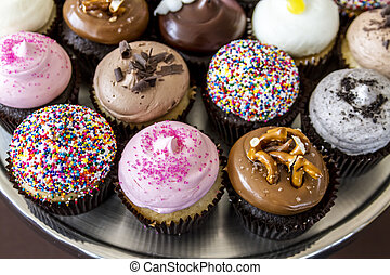 Assorted Flavors of Cupcake on Display - Assorted flavors of...