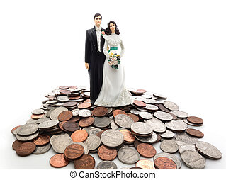 coin couple - Plastic wedding couple on a pile of coins -...