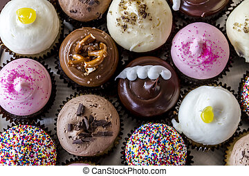 Assorted Flavors of Cupcake on Display - Looking down on...