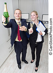 Business celebration - Two colleagues celebrating a business...