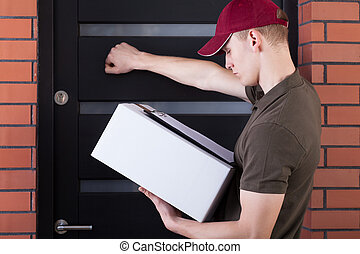 Courier knocking on customer's door - Courier knocking on a...