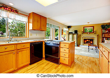 Kitchen cabinets with black stove and washdisher - Kitchen...