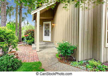 Entrance porch with french door - Wood siding house with...