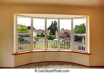 House interior. Window view - Uncurtained wide window with...