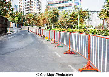 traffic fence on a parking lot in the park.