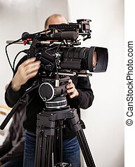 Videoperator shooting a reportage - Man shooting a reportage...