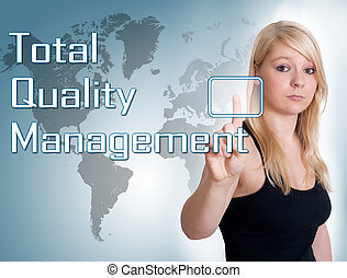 Total Quality Management - Young woman press digital Total...