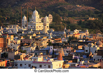 View of Pushkar with Gurudwara temple in the evening, India...