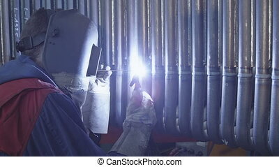 Gas tungsten arc welding - Welding a steel pipes. Gas...