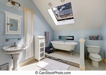 bathroom with antique bath tub - Light blue velux bathroom...