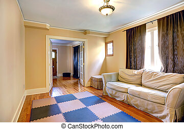 Furnished room with open french door - Light tones room with...