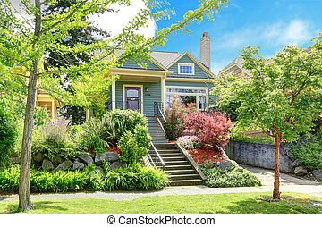 House exterior with beautiful curb appeal - Clapboard siding...