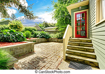 Backyard porch with red french door - Walkout deck with...