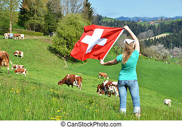 Girl holding the Swiss flag Emmental, Switzerland