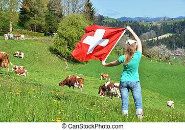 Girl holding the Swiss flag. Emmental, Switzerland