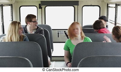 Kids playing and riding a bus - High school kids playing...