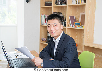 Male staff - Businessman using laptop, looked at the smile...