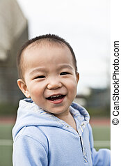 Happy asian boy - A shot of a happy asian boy laughing