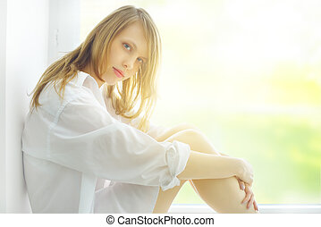 Attractive girl at the window