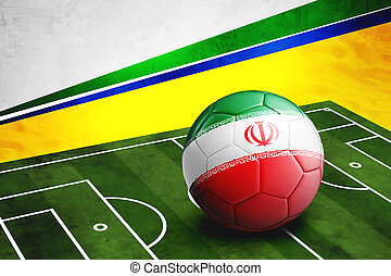 Soccer ball with Iran flag on pitch - Soccer ball with Iran...