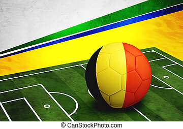 Soccer ball with Belgium flag on pitch