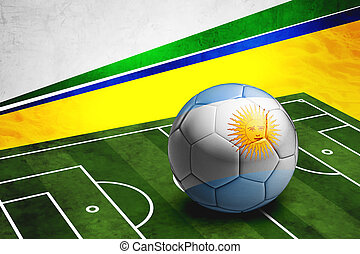 Soccer ball with Argentina flag on pitch