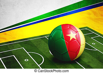 Soccer ball with Cameroon flag on pitch