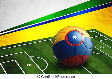 Soccer ball with Columbia flag on pitch