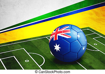 Soccer ball with Australia flag on pitch