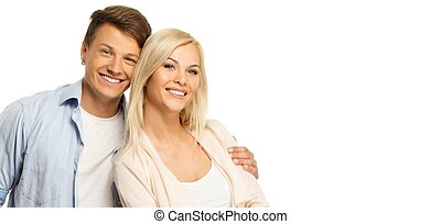 Beautiful smiling young couple isolated on white