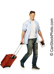 Cheerful young man with suitcase and map