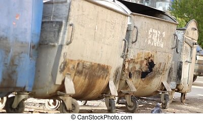 Damaged Dumpsters - Dirty damaged metal dumpsters, on dirty...