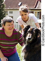 mentally disabled woman with a dog - disabled woman is...