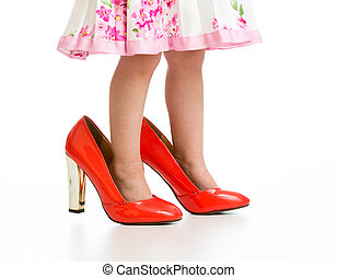 Little girl in big mommy shoes isolated on white - Little...