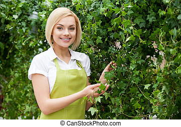 Living a green life. Beautiful young blond hair woman in...
