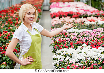 Flowers presentation. Top view of beautiful blond hair woman...