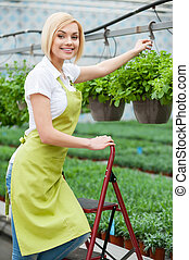 Working in green environment. Beautiful blond hair woman in...