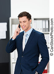 Stylish businessman taking a call on a mobile - Stylish...