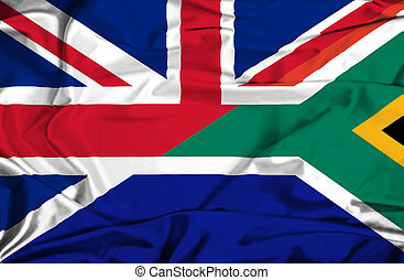 Waving flag of South Africa and UK