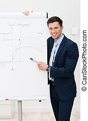 Businessman giving a presentation on a flipchart - Handsome...
