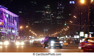 Cars go on the night street, transition from the sharp image...